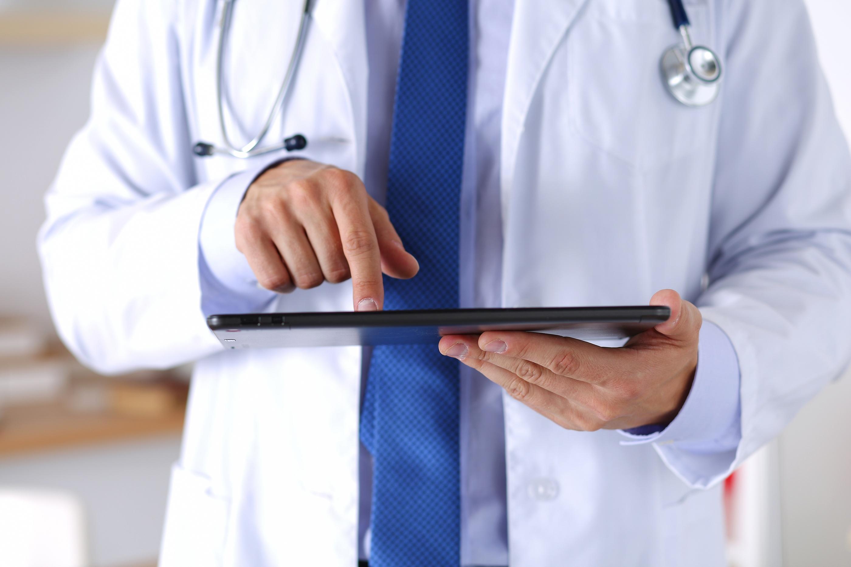 bigstock-Male-Medicine-Doctor-Holding-D-100250879